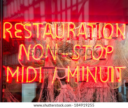 Neon sign of non-stop French restaurant in Toyes, France - stock photo