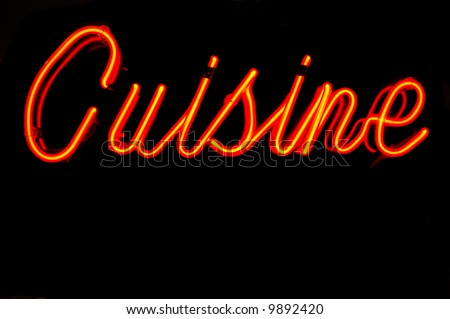 Neon sign on a restaurant advertising cuisine - stock photo