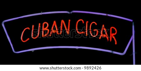Neon sign on a smoke shop advertising Cuban cigars - stock photo