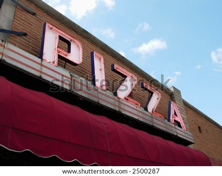 Neon sign on pizza restaurant - stock photo