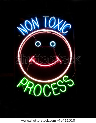 neon sign on window of dry cleaner - stock photo