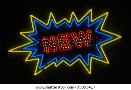 Neon sign promoting a new product or service over dark background - stock photo