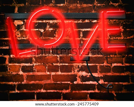 "Neon Sign Red Love. Simulated neon sign with the word ""Love"" in red. - stock photo"