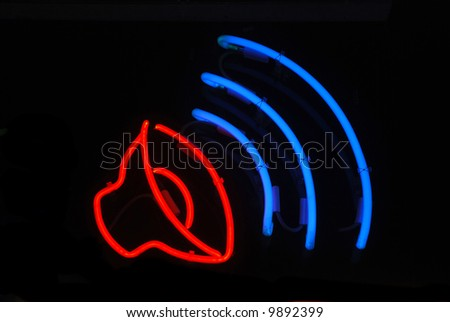 Neon sign with a speaker playing music - stock photo