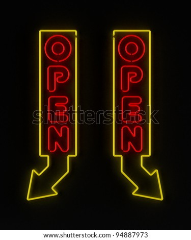 Neon sign with arrow showing an open store