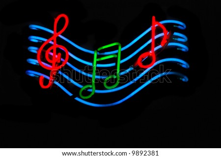 Neon sign with musical notes - stock photo