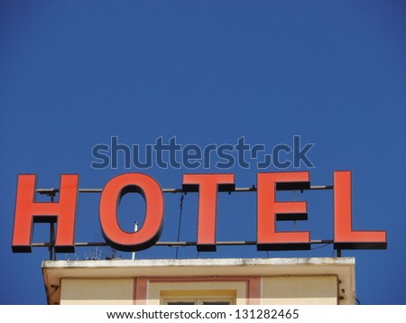 Neon Sign with the word Hotel - stock photo