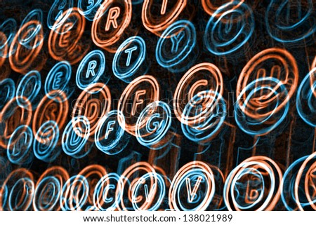 Neon typewriter keys close up, selective focus - stock photo