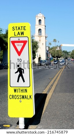 Neon yellow crosswalk sign in down town Ojai - stock photo