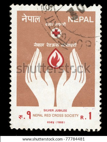 NEPAL - CIRCA 1988: A stamp printed in NEPAL shows image of Nepal Red Cross Society (Hands and Fire symbol), circa 1988.