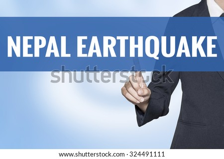 Nepal Earthquake word on virtual screen touch by business woman blue background - stock photo