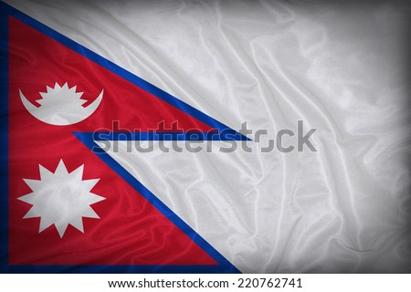 Nepal flag pattern on the fabric texture ,vintage style - stock photo