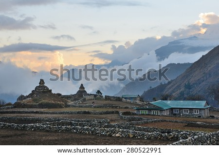 Nepal, village of Phortse Tenga in the Himalayas, 3600 meters above sea level, ancient stupas at sunset