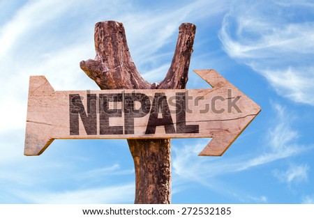 Nepal wooden sign with sky background - stock photo