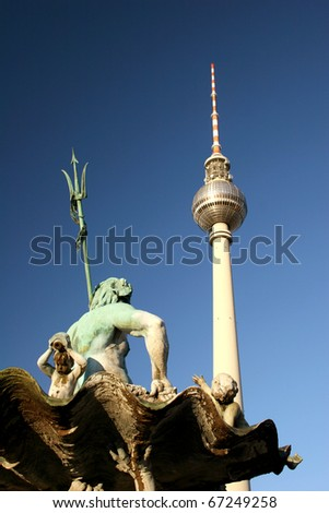 Neptune fountain and TV tower at square Alexanderplatz in Berlin, Germany - stock photo
