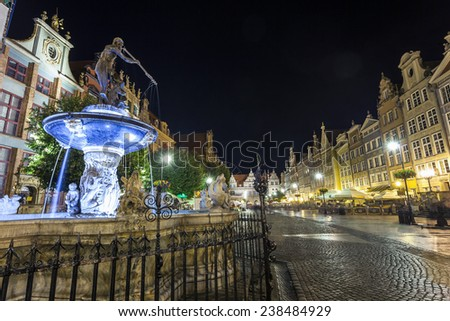 Neptune fountain at Gdansk main street called Dluga  - stock photo