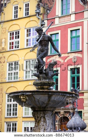 Neptune Fountain (Poseidon in Greek mythology), bronze statue of the Roman God of the Sea in the Old Town of Gdansk, Poland - stock photo