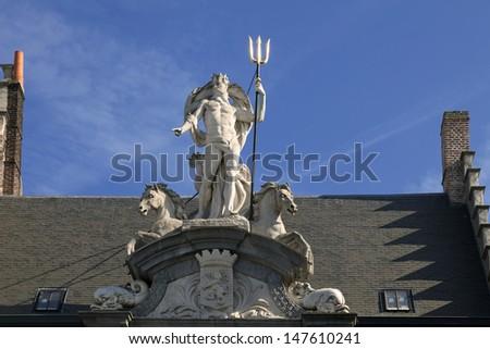 Neptune statue on the house in Gent, Belgium  - stock photo