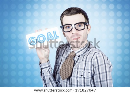 Nerd business man holding goal written on white sign board. Business goals and aspirations concept - stock photo