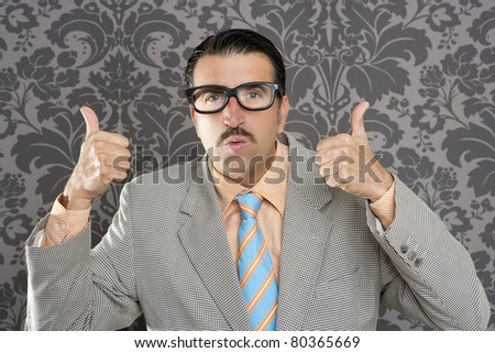 nerd businessman gesturing ok positive with hand over retro wallpaper - stock photo