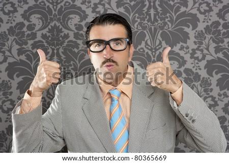 nerd businessman gesturing ok positive with hand over retro wallpaper - stock photo