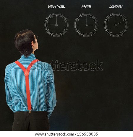 Nerd businessman with chalk time difference clocks on blackboard background - stock photo