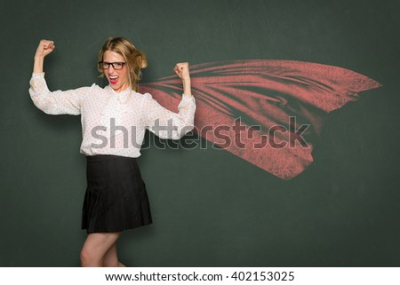 Nerd dork fashion cape super woman celebrates strength power confident ego inner pride independence individuality unique  - stock photo