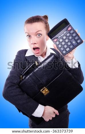 Nerd female accountant with calculator - stock photo