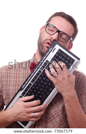 Nerd in love with his keyboard - stock photo