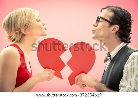 Nerd man boyfriend kiss his girlfriend love portrait with heart for valentine day - stock photo