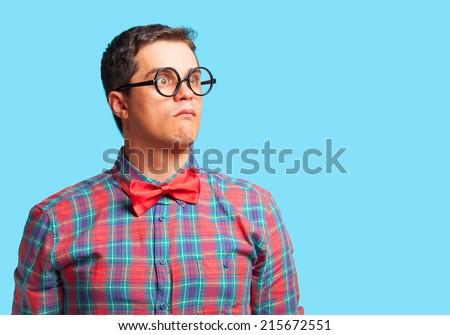 Nerd man in shirt on blue background. - stock photo
