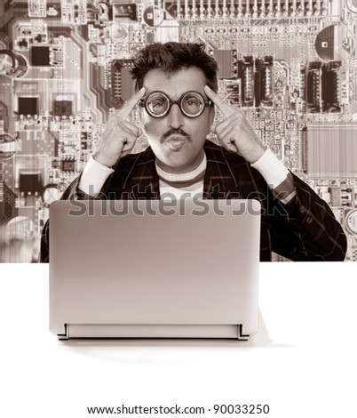 Nerd pensive man with myopic glasses looking for solution on electronics technology problem [ photo-illustration] - stock photo