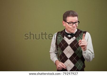 Nerd pointing index finger over green background