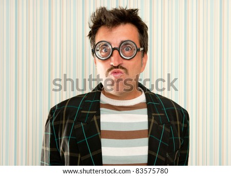 nerd silly myopic man with glasses doing funny expression with retro mustache - stock photo