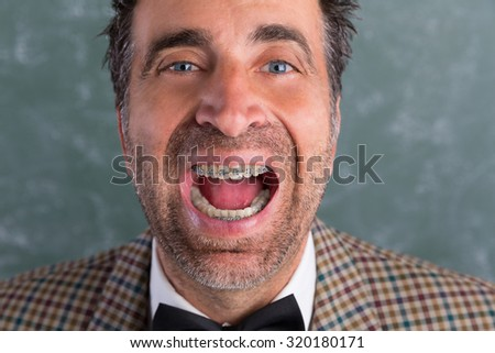 Nerd silly retro man with braces funny expression open mouth