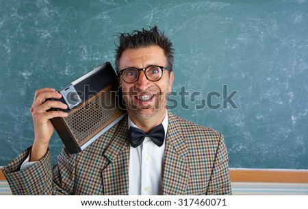 Nerd silly retro teacher man with braces and vintage radio and crazy expression - stock photo