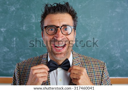 Nerd silly retro teacher man with braces funny expression bow tie portrait - stock photo