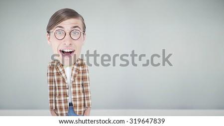 Nerd smiling against room with wooden floor - stock photo