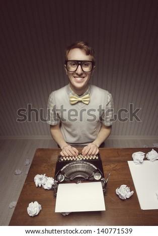 Nerd student journalist and his typewriter - stock photo