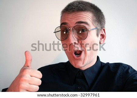 Nerd with glasses and a nice shirt - stock photo
