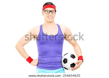 Nerdy athlete holding a football isolated on white background - stock photo
