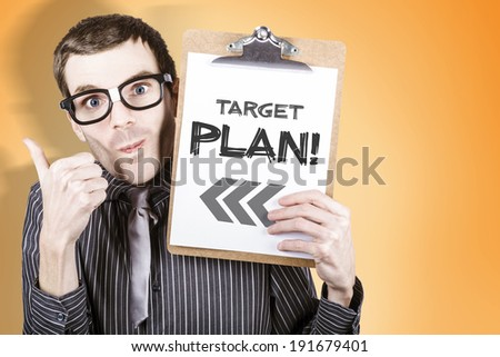 Nerdy businessman gesturing thumb up with clipboard and written target plan - stock photo