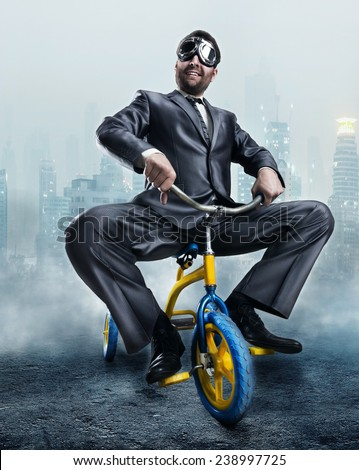 Nerdy businessman riding a small bicycle - stock photo