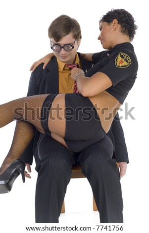 Nerdy businessman sitting on chair with stripteaser on knees. The woman is holding his tie. Man looking frightened. White background, front view - stock photo