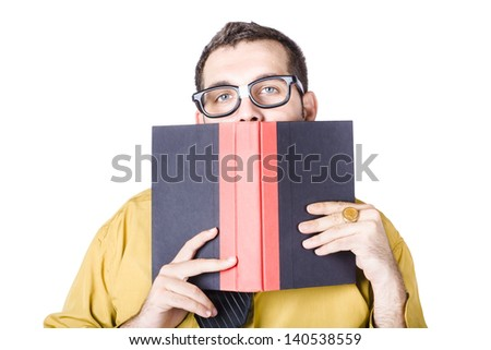 Nerdy businessman with book in front of face, white background - stock photo
