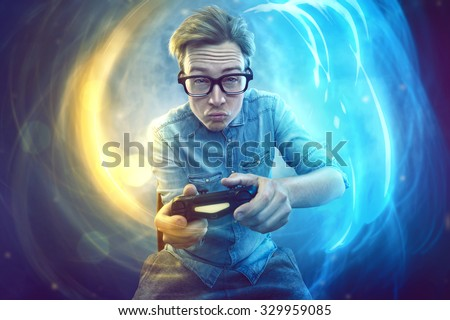 Nerdy gamer with controller - stock photo