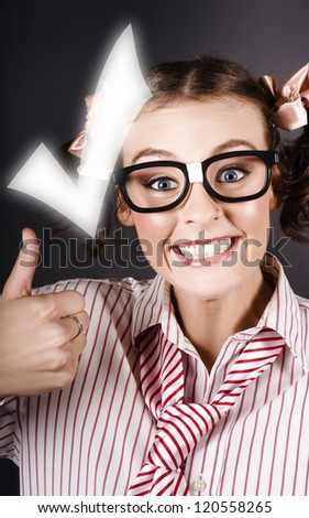 Nerdy Girl Showing Thumbs Up To A Big Tick In A Creative Checklist Concept - stock photo
