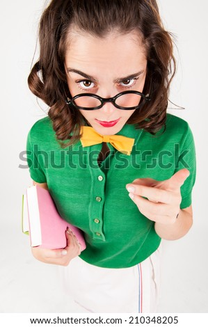 nerdy girl telling someone off. studio shot. - stock photo