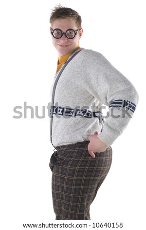 Nerdy guy in tempting pose. Smiling and looking at camera. Pointing at his arse. Side view, white background - stock photo