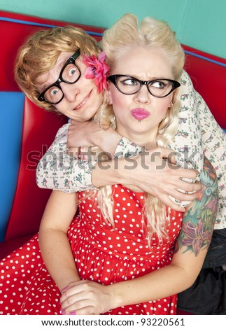 Nerdy Guy Trying to Get Girl's Attention - stock photo